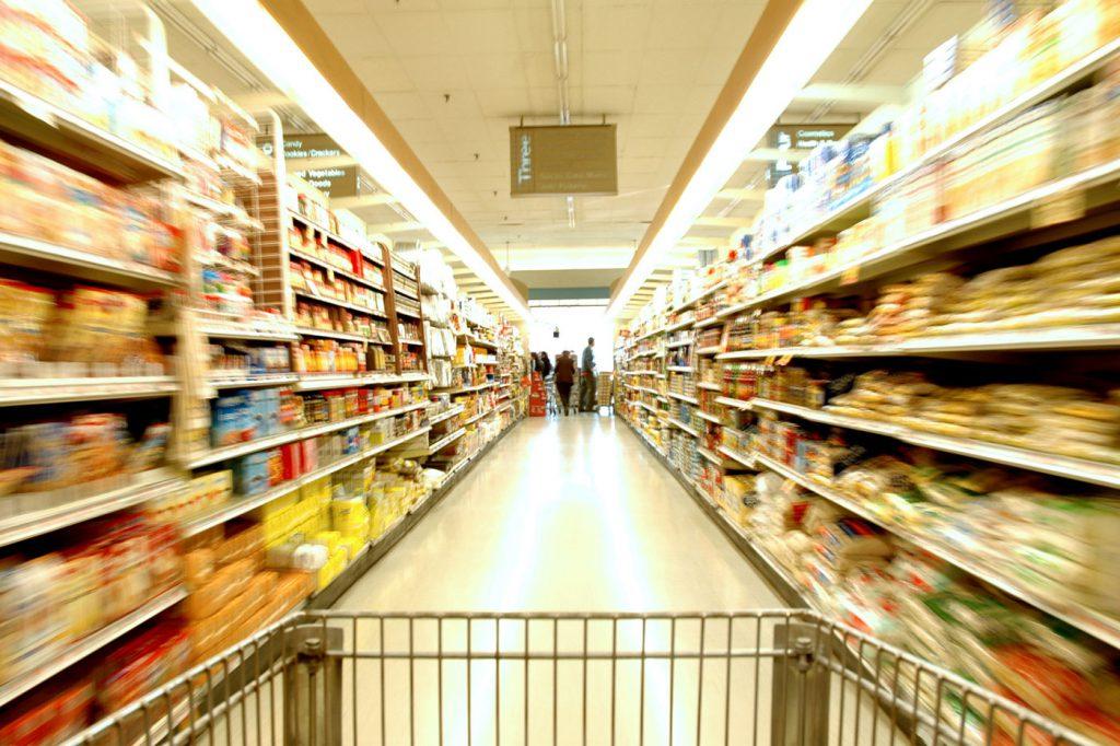 Shopping cart speeding down a long aisle